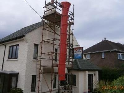Scaffold with rubble chute